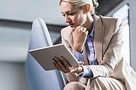 Businesswoman holding tablet - UUF11400