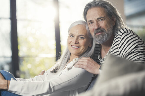 Happy senior couple sitting at home - SBOF00473