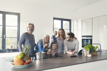 Happy family with grandparents and children standing in the kitchen - SBOF00512