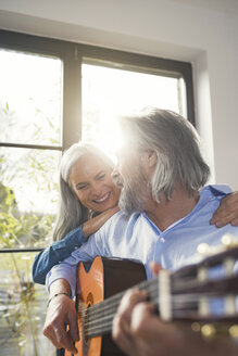 Senior playing guitar and singing loud for his wife - SBOF00551