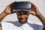 Man putting on Virtual Reality Glasses - MGIF00071