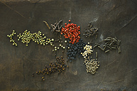 Various sorts of pepper on brown background - ASF06097