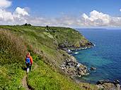 UK, England, Cornwall, The Lizard, woman hiking at the coast near Cadgwith - SIEF07472