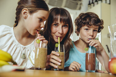 Mother and children enjoying their homemade smoothie - MFF03760