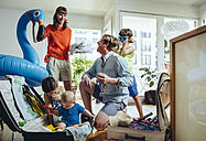 Happy family of five packing for holiday trip - MFF03775