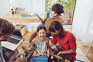 Happy playful family using digital devices in children's room - MFF03796