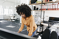 Young woman working in office - KNSF02295