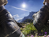Italy Lombardy, Passo di Val Viola, Close up of hiking shoes in the grass - LAF01862