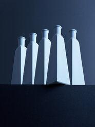 Five bottles in front of dark background, 3D-Rendering - DRBF00022
