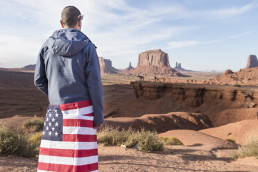 USA, Utah, back view of young man with American flag at Monument Valley - EPF00455