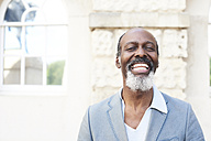 Portrait of laughing bearded man - IGGF00085