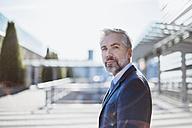 Portrait of confident businessman outdoors - DIGF02614