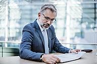 Businessman reading newspaper - DIGF02623