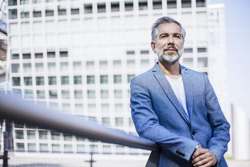 Portrait of confident businessman outdoors - DIGF02635