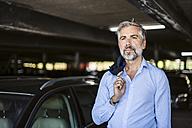 Portrait of businessman in parking garage - DIGF02671