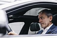 Businessman driving car - KNSF02373