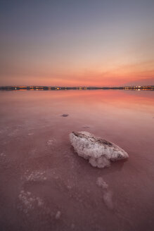 Spain, Alicante, Salinas de Torrevieja, Sunset over pink lake - DHCF00143