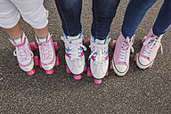 Mother and her two daughters on roller skates, partial view - NMSF00144