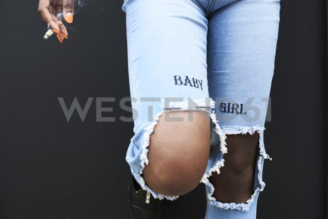Legs of woman wearing used look jeans - IGGF00100