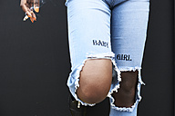 Legs of woman wearing used look jeans - IGGF00100