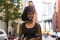 USA, New York City, Brooklyn, portrait of smiling woman - GIOF03078