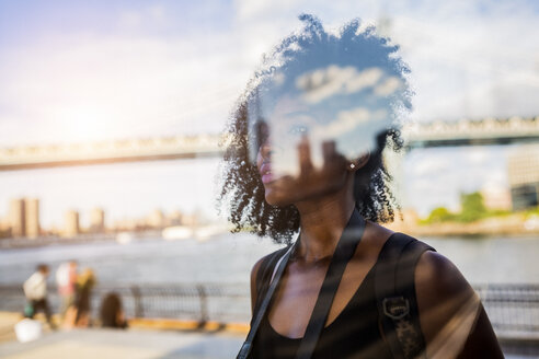 USA, New York City, Brooklyn, reflection of a woman - GIOF03105