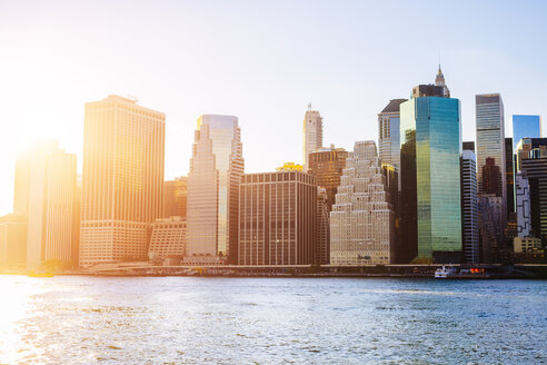 USA, New York City, skyline of Manhattan at sunset - GIOF03126