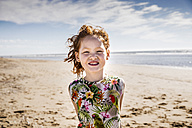 Netherlands, Zandvoort, portrait of redheaded girl on the beach - FMKF04317