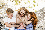 Happy mother with children in hammock - FMKF04335