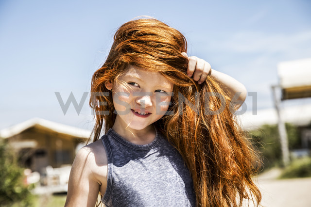 Portrait of a girl with long red hair - FMKF04338