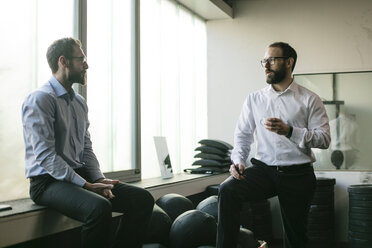 Two businessmen having a meeting in office - JOSF01353