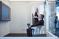 Business people having a video conference in office - ZEF14311