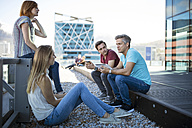 Business people having a casual meeting on a rooftop terrace - ZEF14329