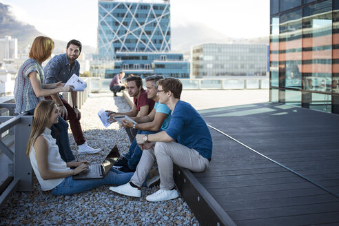 Business people having a casual meeting on a rooftop terrace - ZEF14332