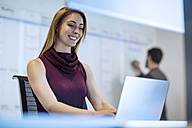 Young woman working in office with a colleague - ZEF14359