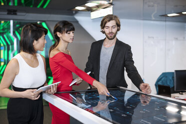 Business people discussing in futuristic office - ZEF14374