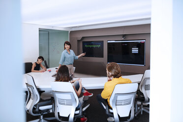 Business people having a meeting in a futuristic office - ZEF14401
