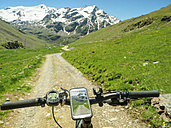 Italy, Lombardy, Cevedale Vioz mountain crest, cell phone on mountain e-bike - LAF01865