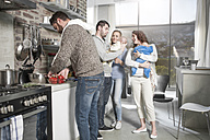 Family and friends with babies in kitchen - ZEF14442