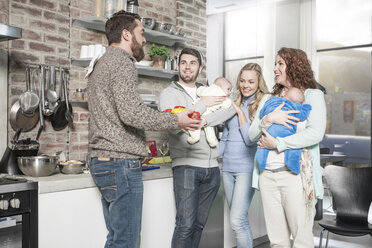 Family and friends with babies in kitchen - ZEF14445