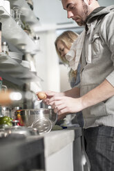 Couple cooking in kitchen - ZEF14454