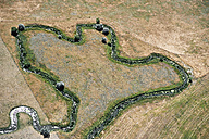 USA, Aerial of stream running through pasture in Western Nebraska - BCDF00311