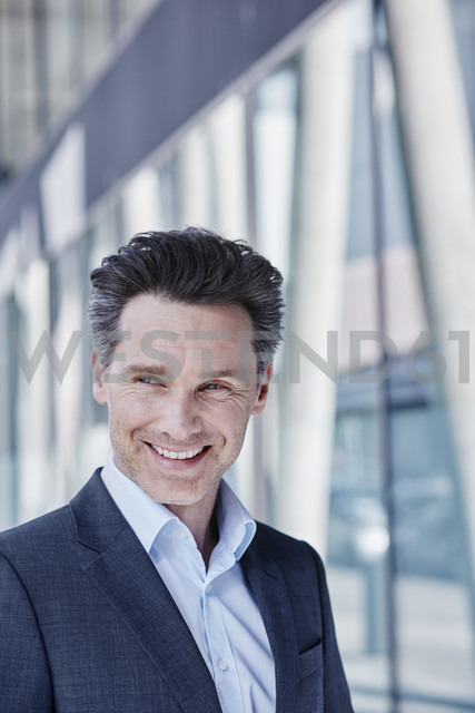 Portrait of smiling businessman - RORF00983