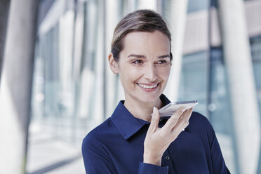 Portrait of smiling businesswoman using cell phone - RORF00989