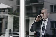 Mature businessman on cell phone - KNSF02399