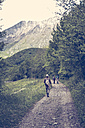 Slovenia, Bovec, three anglers walking on path towards Soca river - BMAF00306