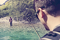 Slovenia, two men fly fishing in Soca river - BMAF00312
