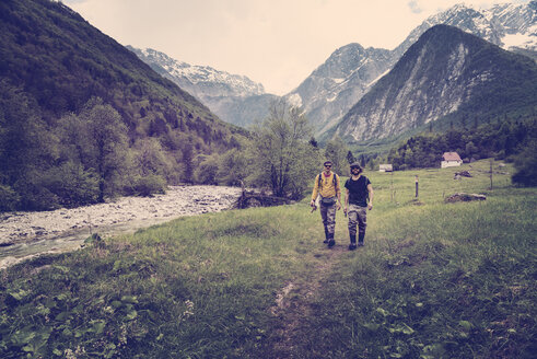 Slovenia, Bovec, two anglers walking on path towards Soca river - BMAF00324