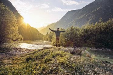 Slovenia, Bovec, man standing at Soca river - BMAF00327