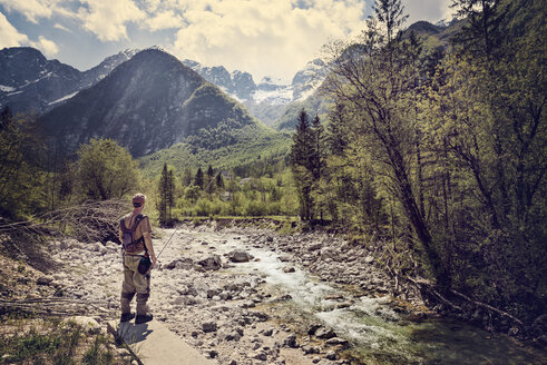 Slovenia, man fly fishing in Soca river - BMAF00342